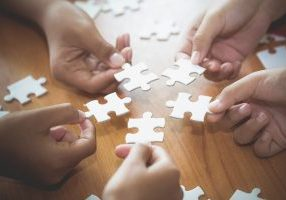 Business Concept,  Group Of Business People Assembling Jigsaw Pu