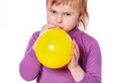 Girl Inflating Balloon