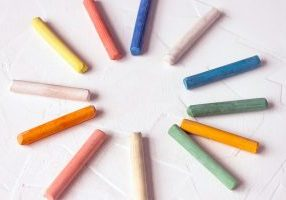Row Of Mixed Color Of Used Chalk Pastel Sticks Crayon Sun Rays C
